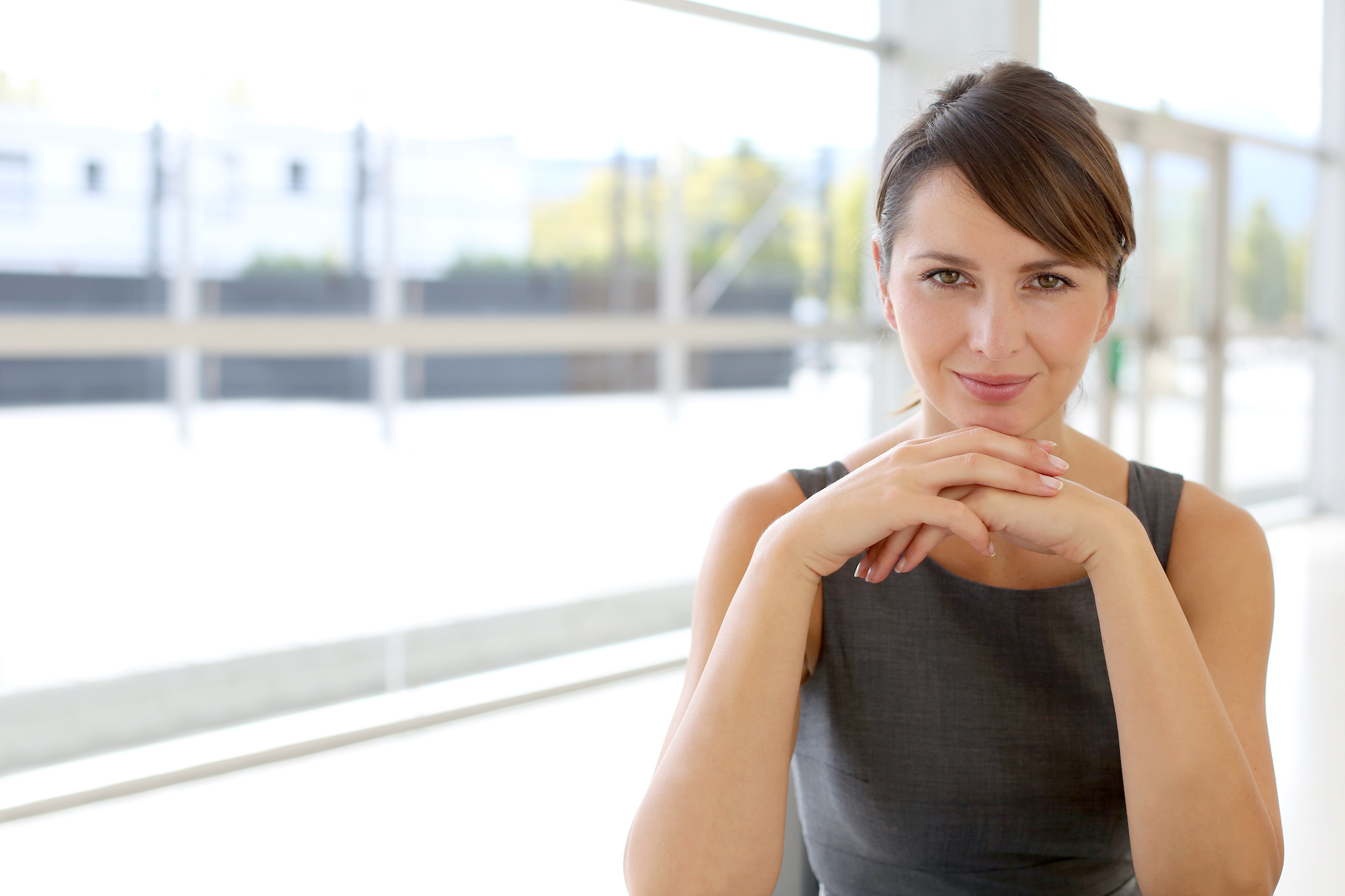 Portrait of attractive businesswoman sitting in modern building